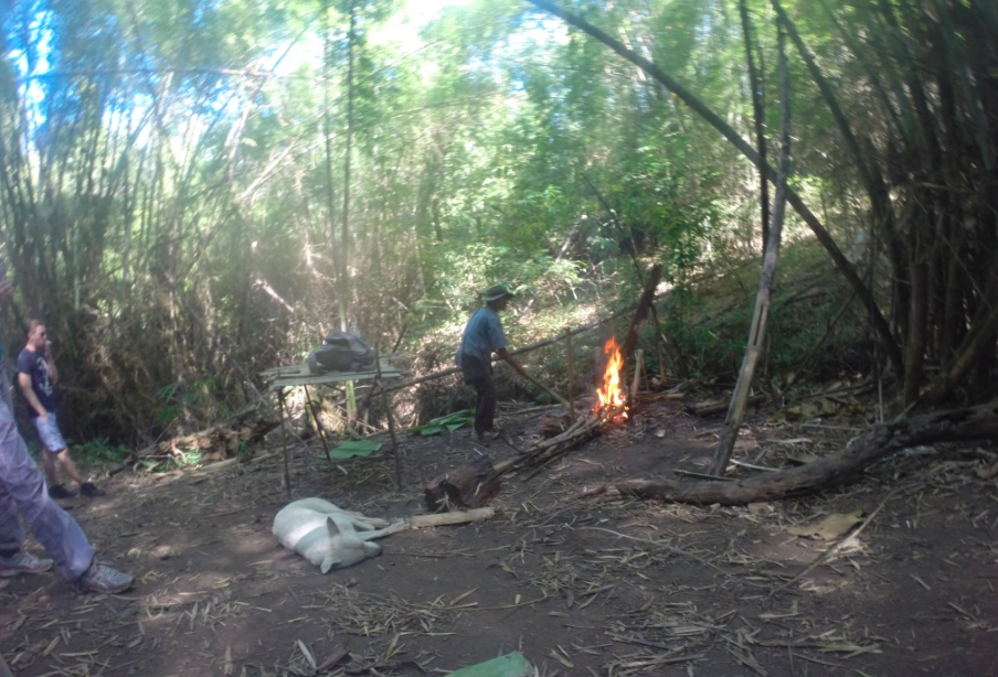 Noi making a fire in his jungle kitchen.